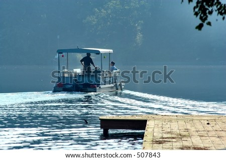 Pontoon boat on a lake - stock photo