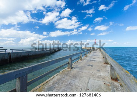 pontoon jetty and channel of grandcamp normandy - stock photo