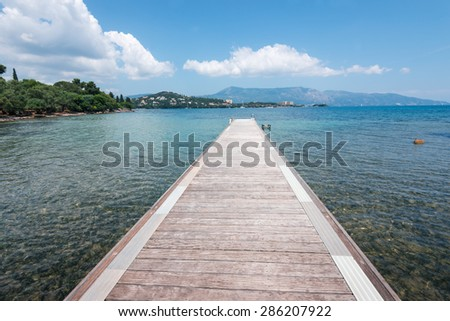 Pontoon on a beach of Ionian Sea  in Greece, Corfu - stock photo