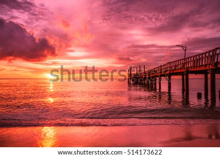 Pontoon with beach and ocean at sunset, colorful beach background and wallpaper, holiday dream