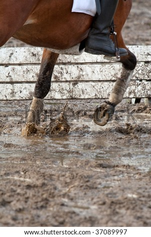 Pony riding in the mud - stock photo
