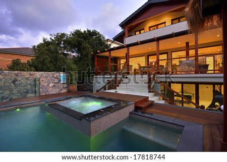 Pool and spa area of a luxury home - stock photo
