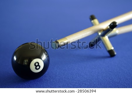 Pool ball and cue on blue table - stock photo