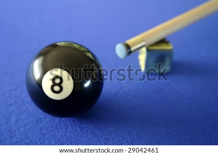 Pool ball, cue and chalk on blue table - stock photo