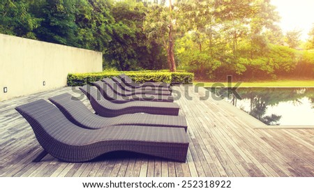 Pool beds on wooden ground with light in vintage style. - stock photo