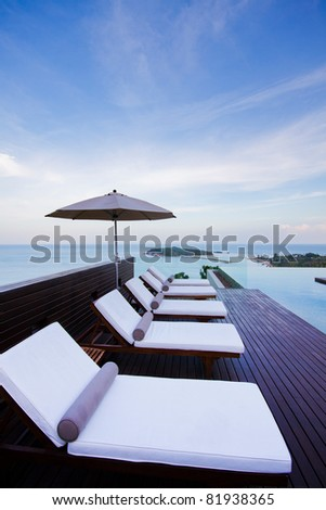 pool chair relaxing on the moutain and seaview - stock photo