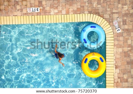 Pool Float in swimming pool, room for your text - stock photo