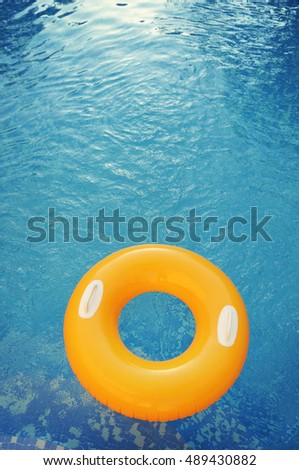 pool float, ring floating in a refreshing blue swimming pool