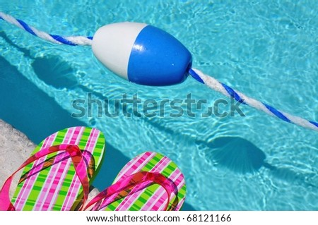 Pool float with pretty flip flops - stock photo
