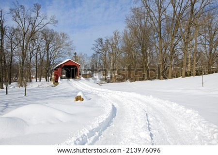 Pool Forge Covered Bridge with snow in Lancaster County,Pennsylvania, USA. - stock photo