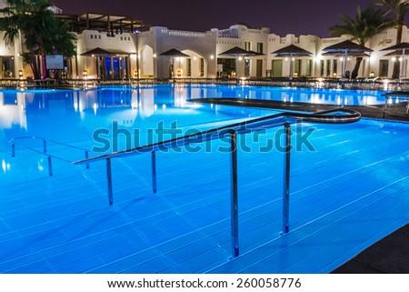 Pool glows, night - stock photo