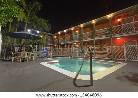 Pool of a motel at night. USA. California.