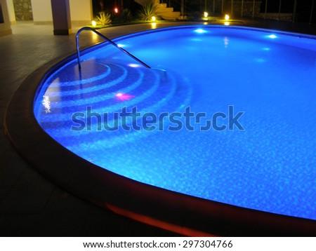 Pool 1. Oval pool with night illumination. - stock photo