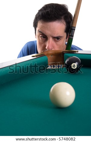 Pool player looking suspiciously to eight ball near corner pocket - stock photo