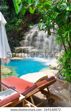 pool rezorte.foto pool with sun beds in one of the Resort on Koh Phangan - stock photo