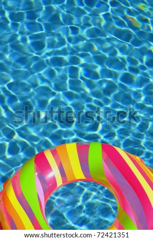 Pool ring / float in swimming pool perfect for cover art - stock photo