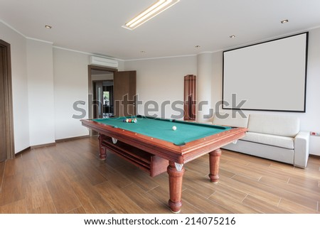 Pool room with empty picture frame - stock photo