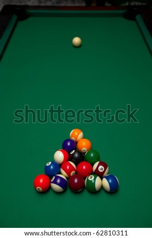 Pool table with all the balls - stock photo
