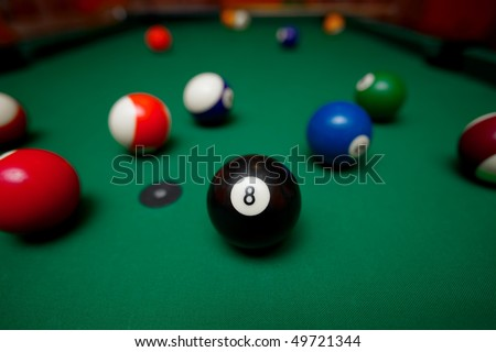 Pool table with the black ball in the middle