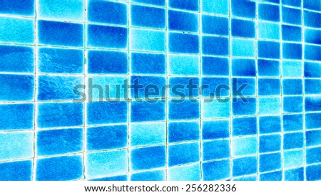 Pool with blue ceramic tiles and water ripple effect - stock photo