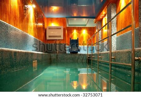 Pool with illumination in a sauna - stock photo
