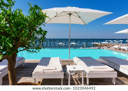 Poolside beach beds and umbrella Italy & Poolside Beach Beds Umbrella Italy Stock Photo 1023046489 - Shutterstock