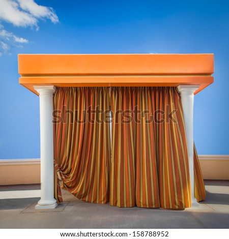 Poolside beach cabana with curtains drawn - stock photo
