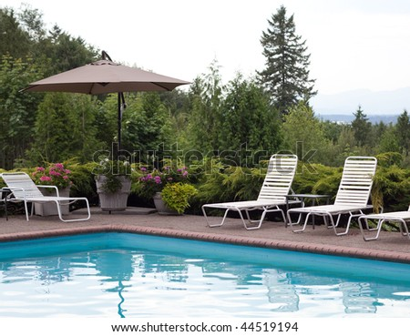 Poolside furniture with a view of the mountains