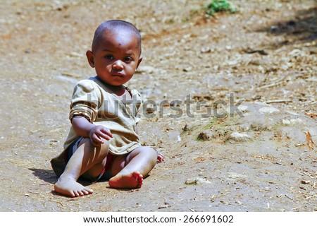 Poor african kid - stock photo