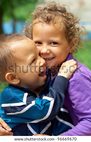 poor and dirty but still happy and smiling little gypsy brother and sister - stock photo