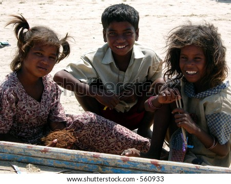 poor children posing for a photograph - stock photo