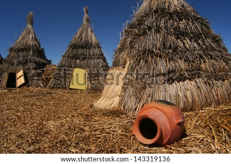 Poor straw Indian houses still life at Uros Islands, Titicaca, Peru  - stock photo