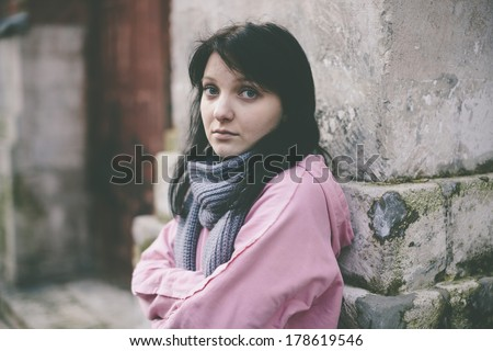 poor young woman on the street - stock photo