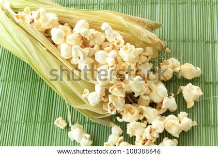 Pop corn in sweet corn - stock photo