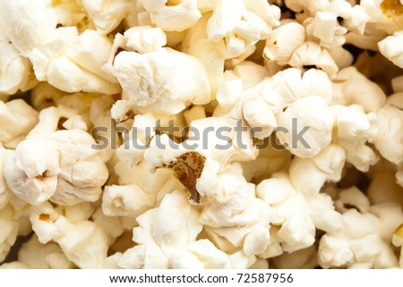 pop corn on a bowl, extreme closeup photo - stock photo