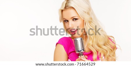 pop female blonde wearing pink singer with the retro microphone banner - stock photo