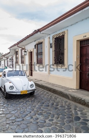 POPAYAN, COLOMBIA - SEPTEMBER 10, 2015: Classic Volkswagen Beetle parked in a center of Popayan - stock photo