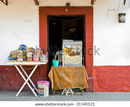 Popcorn and candy for sale outside a house in Mexico - stock photo