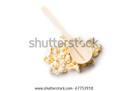 Popcorn and spoon isolated on white - stock photo
