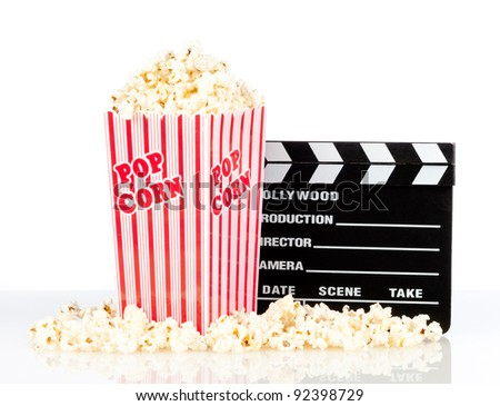 popcorn box with clapper board on white background - stock photo