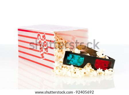 popcorn box with 3d movie glasses on a white background - stock photo