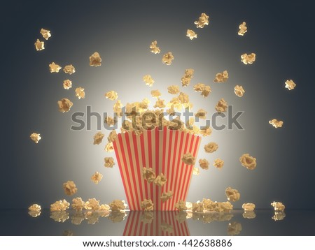 Popcorn exploding out of the striped package. Clipping path included. - stock photo