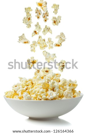 Popcorn falling in a bowl - stock photo