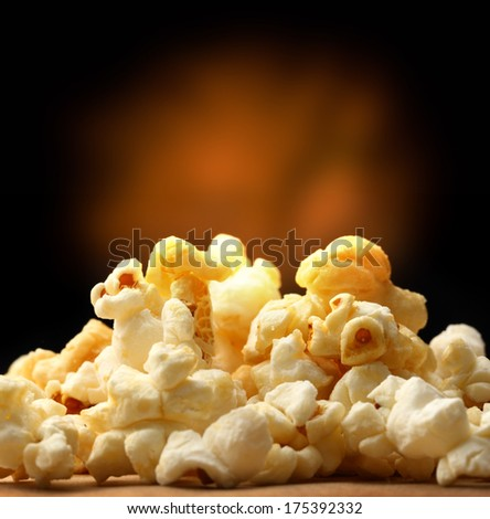Popcorn heap on black background - stock photo