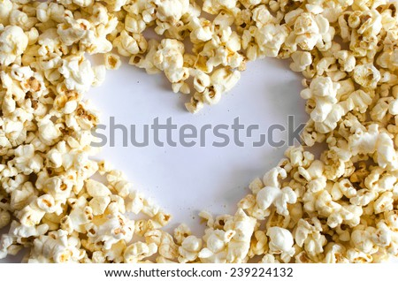 Popcorn Heart , Heart shaped frame made of popcorn over the white background - stock photo
