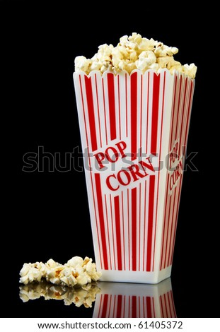 Popcorn in a container ready for the movies or your next project, on a black background.