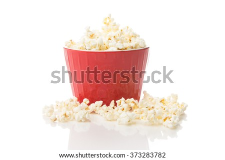 Popcorn in a large red bowl with white background - stock photo