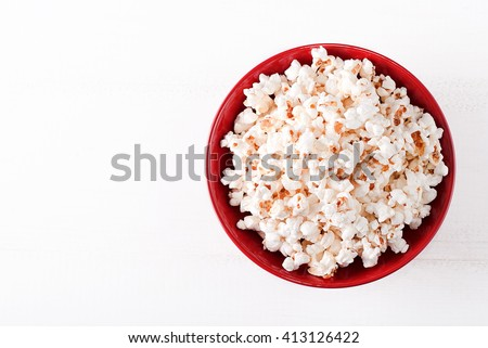 popcorn in a red bowltop view - stock photo