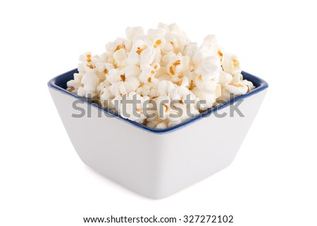 Popcorn in a white bowl on a white background - stock photo