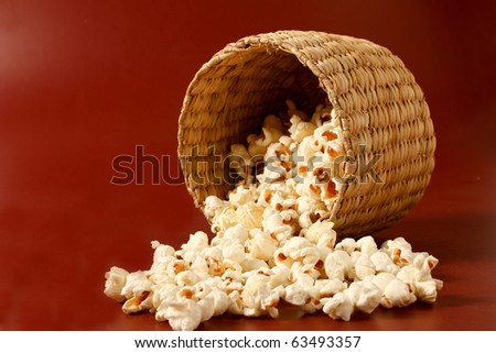 popcorn in basket form of bowl over sheet - stock photo